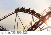 Roller coaster ride against the sky (2018 год). Стоковое фото, фотограф Юрий Бизгаймер / Фотобанк Лори