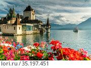 Flowers framing Oberhofen Castle and Lake Thun, Canton of Bern, Switzerland... Стоковое фото, фотограф Roberto Moiola / age Fotostock / Фотобанк Лори