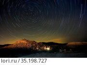 Star trails above The Kasbah Ait-Benhaddou, UNESCO World Heritage... Стоковое фото, фотограф Ed Rhodes / age Fotostock / Фотобанк Лори