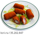 Spanish flamenquines, breaded pork loin rolled with serrano ham. Стоковое фото, фотограф Яков Филимонов / Фотобанк Лори