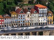 Buildings on Ribeira Negra Street in Porto city on Iberian Peninsula... Стоковое фото, фотограф Konrad Zelazowski / age Fotostock / Фотобанк Лори