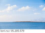 Icelandic landscape. Snowy mountains under clouds. Стоковое фото, фотограф EugeneSergeev / Фотобанк Лори
