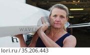 Portrait of senior caucasian woman carrying a rowing boat. Стоковое видео, агентство Wavebreak Media / Фотобанк Лори