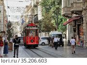 Heritage tram on the Istiklal Avenue, on the Taksim-Tunel Nostalgia Tramway (2020). Beyoglu district, city of Istanbul, Turkey. Редакционное фото, фотограф Bala-Kate / Фотобанк Лори