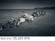Stones lay in a row on a seabed in shallow water. Стоковое фото, фотограф EugeneSergeev / Фотобанк Лори