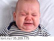 Headshot of a baby that cries. Стоковое фото, фотограф Josep Curto / easy Fotostock / Фотобанк Лори