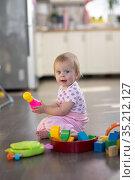 Baby one year old plays. Стоковое фото, фотограф Типляшина Евгения / Фотобанк Лори