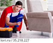 Superhero repairman with tools in repair concept. Стоковое фото, фотограф Elnur / Фотобанк Лори