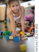 Girl six years old playing. Стоковое фото, фотограф Типляшина Евгения / Фотобанк Лори