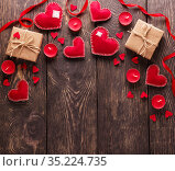 Red hearts, gift boxes and candles on wooden boards. Empty space for congratulations on valentine's day. Стоковое фото, фотограф Сергей Молодиков / Фотобанк Лори