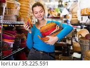 young woman with multicolor wicker basket. Стоковое фото, фотограф Яков Филимонов / Фотобанк Лори