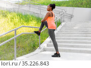 young african american woman stretching outdoors. Стоковое фото, фотограф Syda Productions / Фотобанк Лори