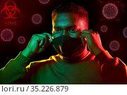 african american man wearing black reusable mask. Стоковое фото, фотограф Syda Productions / Фотобанк Лори