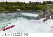 The Rhine Falls at day, tourist boat with passengers (2017 год). Редакционное фото, фотограф EugeneSergeev / Фотобанк Лори