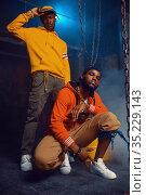 Two stylish rappers poses in studio. Стоковое фото, фотограф Tryapitsyn Sergiy / Фотобанк Лори