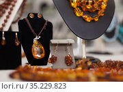 Womens jewelry from amber in a jewelry store. Стоковое фото, фотограф Яков Филимонов / Фотобанк Лори