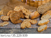 Various kinds of bread and bakery products on table. Стоковое фото, фотограф Яков Филимонов / Фотобанк Лори
