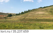 Hills and valleys with grasslands are in Bashkortostan republic, panoramic review at summer season. Russia. Стоковое видео, видеограф Кекяляйнен Андрей / Фотобанк Лори