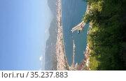 Aerial view at the Alanya port and the city. Vertical video. It is a resort town on Turkey's central Mediterranean coast, Turkey. Стоковое видео, видеограф Кекяляйнен Андрей / Фотобанк Лори