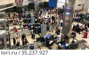 Passenger and baggage screening and reconciliation are in departure terminal of Fraport TAV Antalya Airport. Aviation security personnel is at work. Antalya, Turkey. Редакционное видео, видеограф Кекяляйнен Андрей / Фотобанк Лори