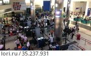 Passenger baggage security check service is in departure terminal of Fraport TAV Antalya Airport. Russian travellers and baggage sreening and reconciliation. Antalya, Turkey. Редакционное видео, видеограф Кекяляйнен Андрей / Фотобанк Лори