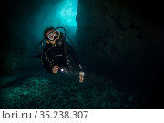 Taiwanese diver exploring a shallow cave, Green Island, Taiwan. Стоковое фото, фотограф Magnus Lundgren / Wild Wonders of China / Nature Picture Library / Фотобанк Лори