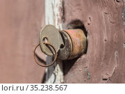 Key in the Old Door Lock Close-up. Стоковое фото, фотограф Юрий Бизгаймер / Фотобанк Лори