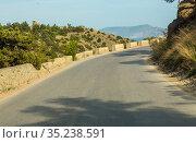 Winding serpentine road in the mountains. Стоковое фото, фотограф Юрий Бизгаймер / Фотобанк Лори