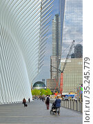 Famous World Trade Center Transportation Hub and skyscrapers in spring. New York City (2019 год). Редакционное фото, фотограф Валерия Попова / Фотобанк Лори