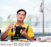 Construction worker sitting at the desk. Стоковое фото, фотограф Elnur / Фотобанк Лори