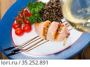 Tasty stuffed sea squid with peppers, eggs and wild rice. Стоковое фото, фотограф Яков Филимонов / Фотобанк Лори