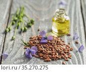 Flax seeds and flaxseed oil with copy space. Стоковое фото, фотограф Ольга Сергеева / Фотобанк Лори
