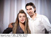 A funny couple of a thin young man and a plump girl with long pigtails. Boy and Girl in love. Стоковое фото, фотограф Кривошеина Елена Леонидовна / Фотобанк Лори