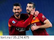 Henrikh Mkhitaryan celebrates with Leonardo Spinazzola (Roma) after... Редакционное фото, фотограф Federico Proietti / Sync / AGF/Federico Proietti / / age Fotostock / Фотобанк Лори