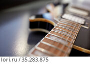 close up of bass guitar neck and strings. Стоковое фото, фотограф Syda Productions / Фотобанк Лори