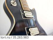 close up of bass guitar strings. Стоковое фото, фотограф Syda Productions / Фотобанк Лори