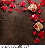 Romantic valentine's day. Postcard, red hearts, candles and romantic mood on dark background. Стоковое фото, фотограф Сергей Молодиков / Фотобанк Лори