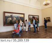 "Visitors in the hall of the famous Russian artist Viktor Vasnetsov at his painting ""The Knight at the Crossroads"". State Russian Museum, St. Petersburg. Russia (2015 год). Редакционное фото, фотограф Наталья Волкова / Фотобанк Лори"