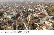 Scenic view from drone of Liberec cityscape with ancient Town Hall on sunny autumn day, Czech Republic. Стоковое видео, видеограф Яков Филимонов / Фотобанк Лори