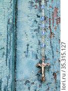 Rosary hanging on a blue wooden shutter. Saint-Gervais-les-Bains.... Стоковое фото, фотограф Catherine Leblanc / easy Fotostock / Фотобанк Лори