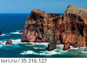 Cliffs at St Lawrence Madeira showing unusual vertical rock formation. Стоковое фото, фотограф Zoonar.com/Phil Bird / easy Fotostock / Фотобанк Лори