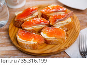 Sandwiches with salmon and butter on white plate. Стоковое фото, фотограф Яков Филимонов / Фотобанк Лори