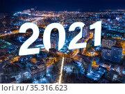 Aerial view of the night modern city. Bright lights of the night streets. Word 2021. Стоковое фото, фотограф Евгений Ткачёв / Фотобанк Лори