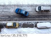 Colored cars in a winter parking lot. Top View. Стоковое фото, фотограф Азат Хайрутдинов / Фотобанк Лори