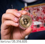 Young man in bitcoin mining concept. Стоковое фото, фотограф Elnur / Фотобанк Лори
