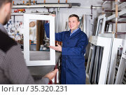 Labour demonstrating PVC profiles. Стоковое фото, фотограф Яков Филимонов / Фотобанк Лори