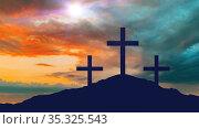 silhouettes of three crosses on calvary hill. Стоковое фото, фотограф Syda Productions / Фотобанк Лори