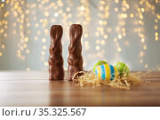 easter eggs in straw nest and chocolate bunnies. Стоковое фото, фотограф Syda Productions / Фотобанк Лори