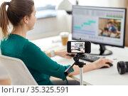 smartphone recording woman working in video editor. Стоковое фото, фотограф Syda Productions / Фотобанк Лори