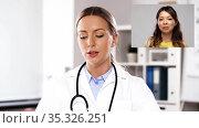 female doctor having video call with patient. Стоковое видео, видеограф Syda Productions / Фотобанк Лори